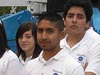 A picture of three young people wearing white shirts