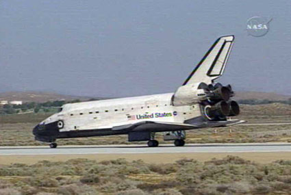 Atlantis lands in the California desert at Edwards Air Force Base.