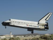 Space Shuttle Atlantis settles down toward Runway 22 at Edwards Air Force Base as it concludes its historic final servicing mission to the Hubble Space Telescope.