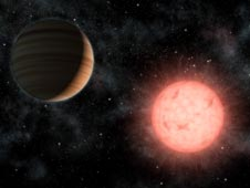 This artist's concept shows the smallest star known to host a planet.
