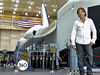 Host Johnny Alonso stands in front of a shuttle trainer