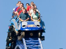 Riders on a roller coaster.