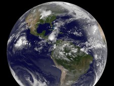 A full satellite image of the Earth taken from the GOES-12 satellite. The Low is located to the far left as the circle of clouds in the open waters of the eastern Pacific Ocean.