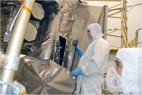 Engineers in the Goddard clean room prepare to mount the panel to the LRO spacecraft