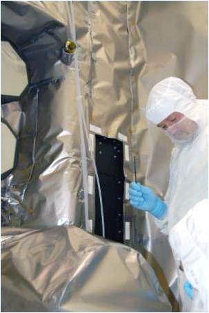 The panel containing the microchip is placed on the LRO spacecraft