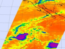 This infrared Aqua satellite AIRS image shows the Low's thunderstorms (purple and blue) are getting well organized in a circular shape.