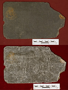 Slate tablet covered with sketches, words and numbers recovered from Jamestown settlement well
