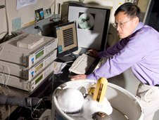 Researcher Fang Zhong analyzes ices like those found on Saturn's moon Titan.