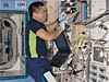 Japanese astronaut Koichi Wakata works on an experiment