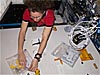 Astronaut Sandra Magnus works with an experiment on the space station