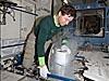 Astronaut Michael Barratt inserts urine samples into a freezer