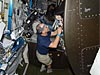 Astronaut Donald Pettit works with wires on the space station