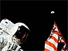 Apollo astronaut and American flag on the moon