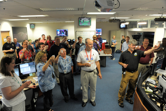 LRO controllers, scientists and others toast the successful lunar orbit insertion