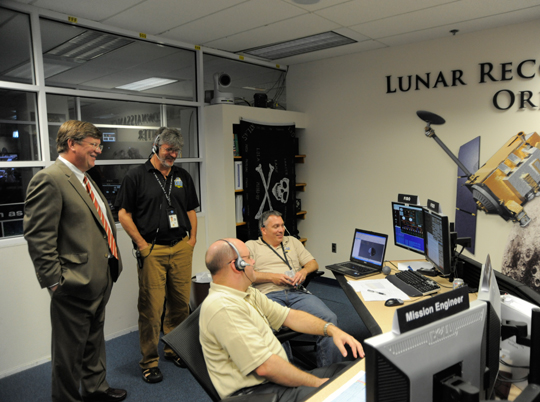 Goddard Center Director Rob Strain (left) and LRO Project Manager Craig Tooley chat with controllers (seated).