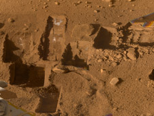 Several of the trenches dug by NASA's Phoenix Mars Lander are displayed.