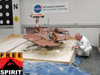 Rover driver Paolo Bellutta measures how much the rover moved sideways, downslope, during the maneuver.