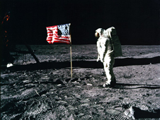 Buzz Aldrin and the U.S. flag on the surface of the moon.