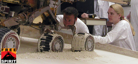 Engineers check the exact position of a test rover in preparation for the next test of a possible maneuver for Spirit to use on Mars.