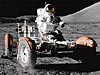 An astronaut sits in a lunar rover on the moon
