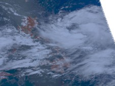 Tropical Depression Isang is pictured on the right of this NASA Aqua satellite image.