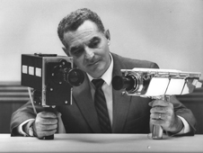 Stan Lebar holds the two cameras that were used on the Apollo 11 missions
