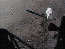 Apollo 11 astronaut sets up a camera on the moon