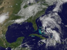 Two comma-like cloud formations, one east of Florida's east coast, and the other with its