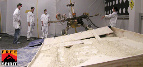 Rover team members discuss the next step in preparing for a new phase in testing of possible moves for getting NASA's Mars rover Spirit out of a sandtrap on Mars.