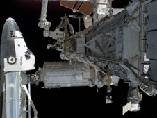 The space shuttle docks with the International Space Station.