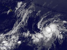 A large swirl of clouds taking on the shape of a tropical depression.
