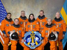 The crew of STS-128 in their orange launch and entry suits