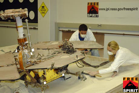 Rover testing maneuvers in a sandbox at the Jet Propulsion Laboratory aimed to help free the Spirit rover stuck on Mars.