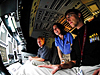 NASA Edge hosts Chris and Blair get instructions inside a space shuttle simulator
