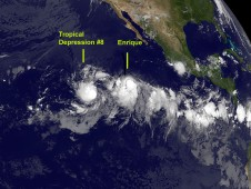 Tropical Depression 8e's (left) and Tropical Storm Enrique's (right) clouds in the early morning hours of August 4, 2009.