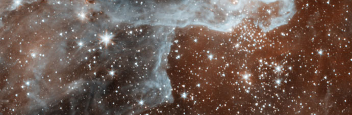 Spitzer image of a cloud bursting with stars in the Cygnus region of the sky.