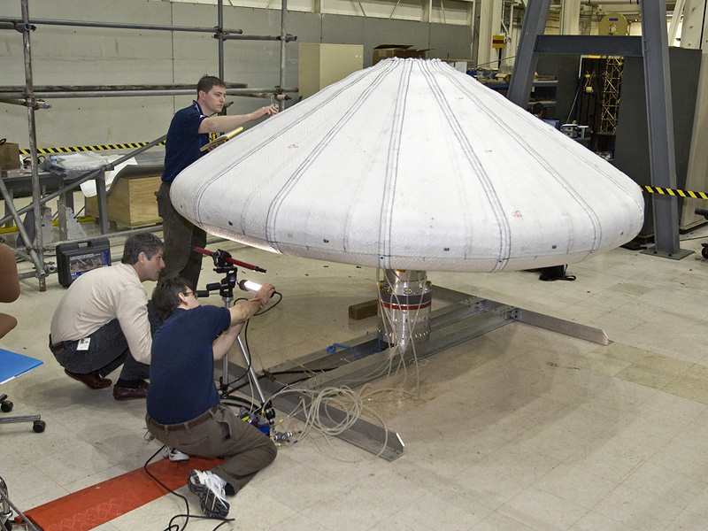 NASA engineers check out the Inflatable Re-entry Vehicle Experiment (IRVE) in the lab