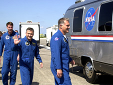 STS-112 crew members head for the Astrovan after exiting the crew transport vehicle