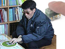A blind person uses the dielectric elastomer EAP based refreshable Braille display developed at Sungkyunkwan University, South Korea.