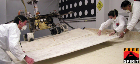 In this image from Aug. 12, 2009, rover team members are moving a board used in getting the setup ready for the next test.