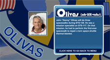 A close-up view of the name Olivas on the STS-128 mission patch and a photo of Danny Olivas