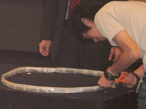 Competitor unwraps 2-meter tether loop in preparation for the challenge pull test