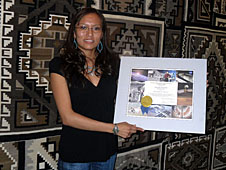 Anjanette Hawk holds a certificate