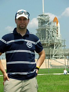 Ryan Kobrick stands in front of space shuttle Endeavour on Launch Pad 39A