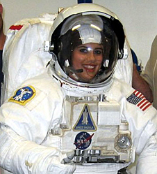 Erica Furnia in a white spacesuit