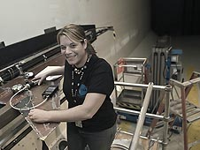 Christie Funk works on a wing model in a wind tunnel