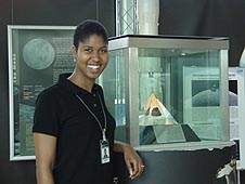 Danielle Wood stands beside a lunar sample