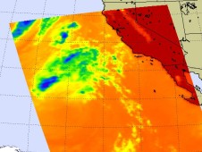 This infrared satellite image shows a faded Ignacio and a view of a forest fire plume.