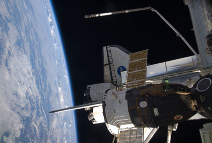S128-E-007429: Soyuz and Discovery docked to International Space Station