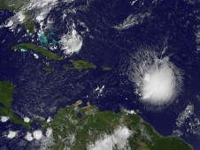 Tropical Storm Erika (right), east of the Leeward Islands this morning, September 2 at 7:45 a.m.